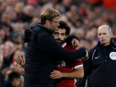 Liverpool manager Jurgen Klopp embraces Mohamed Salah after he is substituted off. Reuters