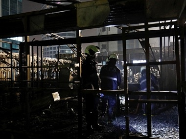 Firemen inspect the debris after fire engulfed one of the restaurants inside Kamala Mills Compound in Mumbai. Reuters