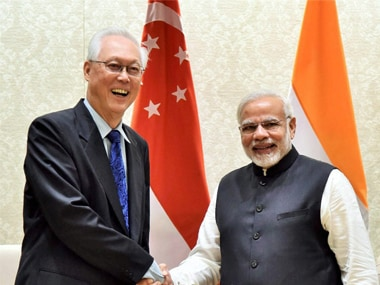 Former Prime Minister of Singapore, Goh Chok Tong shakes hands with Prime Minister, Narendra Modi during a meeting  in New Delhi on Wednesday. PTI
