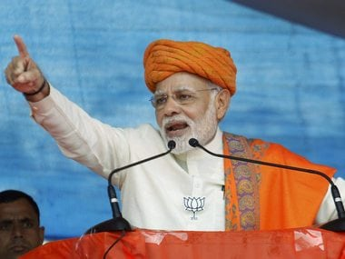 Prime Minister Narendra Modi addresses an election campaign rally, at Dhandhuka village of Ahmedabad district on Wednesday. PTI
