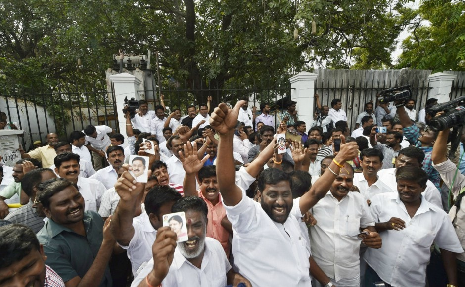 Supporters of Dhinakaran celebrate after he established a decisive lead during the counting of votes for RK Nagar bypoll, outside the counting centre in Chennai on Sunday. PTI