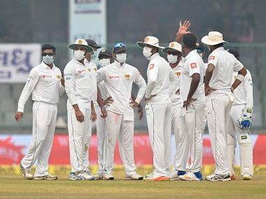 Sri Lankan players wear anti-pollution masks on the field as the air quality deteriorated during the second day of their third Test. PTI