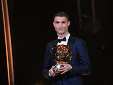 Cristiano Ronaldo with the Ballon d'Or France Football trophy. AFP/ L'EQUIPE