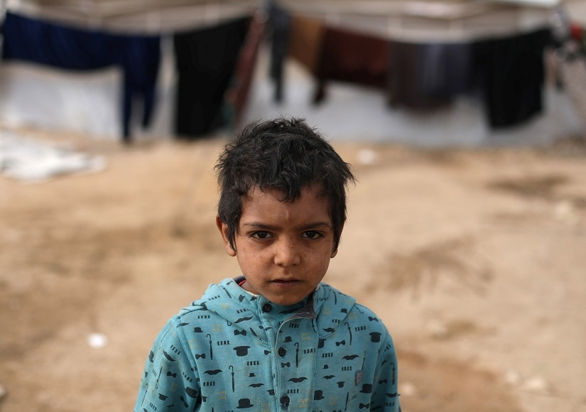 An internally displaced boy who fled Deir al-Zor is pictured at Qana refugee camp in the southern Hasakah, Syria November 26, 2017. REUTERS/Rodi Said - RC1F817DE180