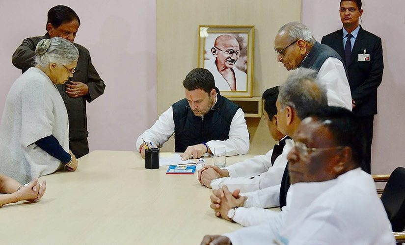New Delhi: Congress Vice President Rahul Gandhi with party leaders Moti Lal Vohra, Shiela Dixit and others as he files his nomination papers for party president's post at the party headquarters in New Delhi on Monday. PTI