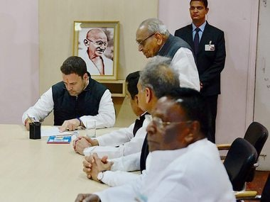 File image of Congress vice-president Rahul Gandhi with party leaders Moti Lal Vohra, Shiela Dixit and others at the time of filing his nomination papers for party president's post . PTI