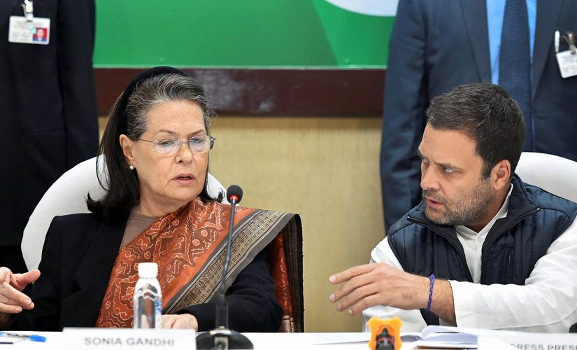 Congress President Rahul Gandhi sits with his mother and former Congress president Sonia Gandhi at the Congress Working Committee (CWC) meeting in New Delhi on Friday. PTI