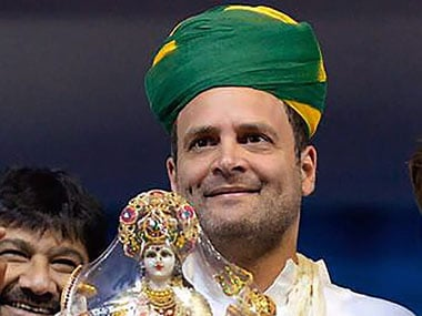 Congress party's vice president Rahul Gandhi holds a memento of Hindu Goddess Durga presented to him during an election campaign rally in Gandhinagar on Monday. PTI