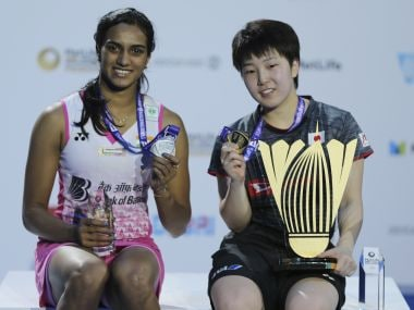 Akane Yamaguchi, right, and India's PV Sindhu pose with their trophies on Sunday. AP