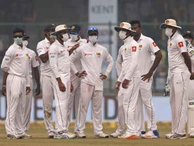 Sri Lanka's players wear anti-pollution masks during the third Test against India. AP