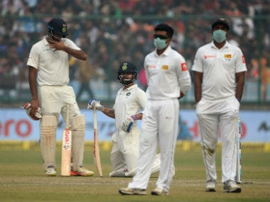 Sri Lankan players wear masks in an attempt to protect themselves from air pollution. AFP