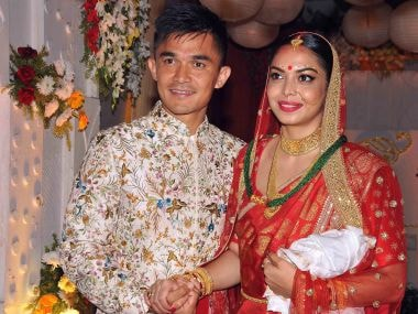 Indian football captain Sunil Chhetri with his wife Sonam posing after their wedding at Ordnance Club in Kolkata on Monday late evening. PTI