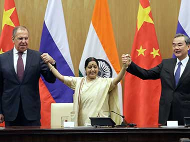 External affairs minister Sushma Swaraj poses with her Chinese counterpart Wang Yi and Russian counterpart Sergey Lavrov after their tri-lateral meeting in New Delhi. AP