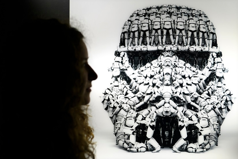 "A person looks at a Stormtrooper photograph made by Hyperactives Studio as part of the new exhibition at Maison d' Ailleurs, ""Je suis ton pere!"". Wednesday, Dec. 6, 2017 in Yverdon. 13 artists revisit the world of Star Wars in the exhibition ""I'm your father!"" which runs from 10 December 2017 to 14 October 2018. (Laurent Gillieron/Keystone via AP)"
