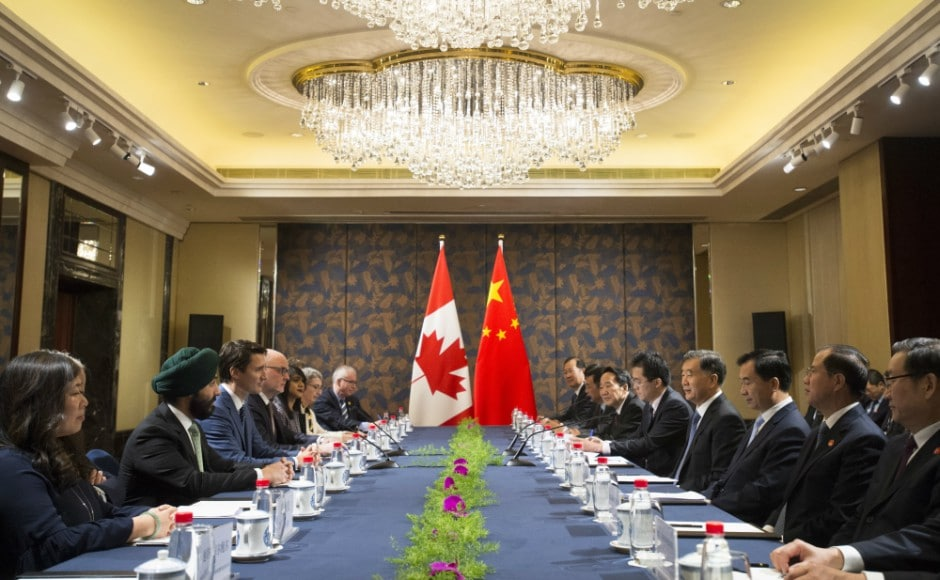 Canadian prime minister Justin Trudeau departed Beijing for Guangzhou after meeting with Chinese premier Li Keqiang on Monday, telling reporters that progress towards free trade talks would not be swift. AP