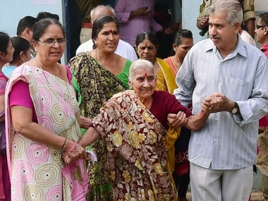 Senior citizen coming out after casting their vote during the first phase of Gujarat state assembly election in Rajkot on Saturday. PTI