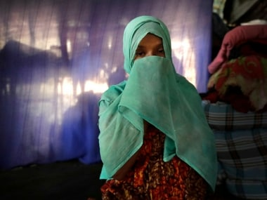F, 22, pregnant, prays in her tent in Kutupalong refugee camp in Bangladesh. AP