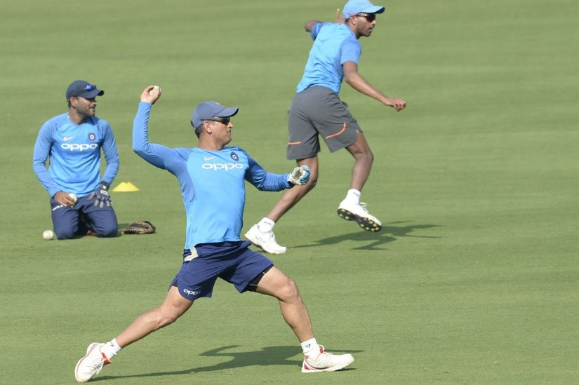 MS Dhoni warms-up ahead of the third ODI in Visakhapatnam. AFP