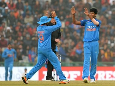 Washington Sundar (R) celebrates after dismissing Sri Lanka's Lahiru Thirimanne during the second ODI in Mohali on Wednesday. AFP