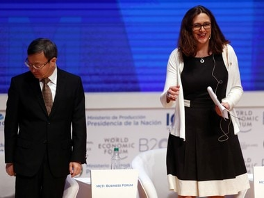 European Commissioner for Trade Cecilia Malmstrom smiles next to China's Vice Minister of Commerce Wang Shouwen during the Business Forum at the 11th World Trade Organization's ministerial conference in Buenos Aires, Argentina. Reuters