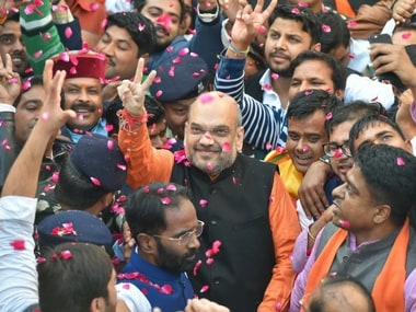 BJP President Amit Shah flashes victory sign as he is welcomed on his arrival at the party headquarters in New Delhi on Monday, after the party's victory in the Assembly elections in Gujarat and Himachal Pradesh. PTI