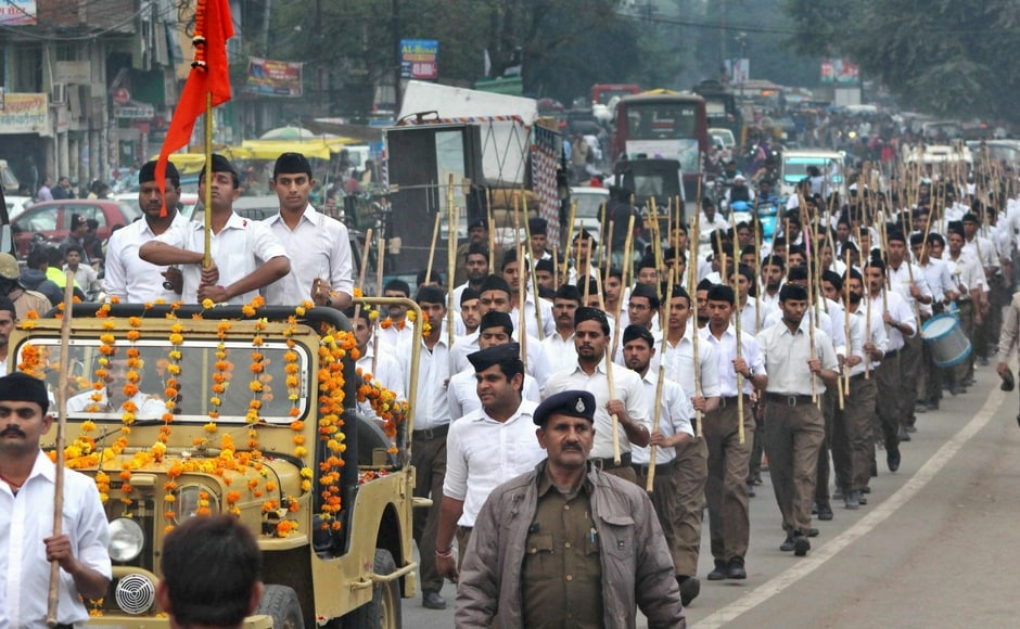 """Rashtriya Swayamsevak Sangh (RSS) activists participated in a march as they observed """"Shaurya Diwas"""" in Bhopal on Wednesday. PTI"""