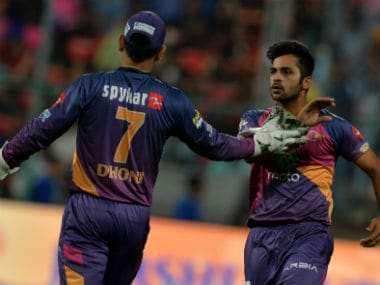 File photo of MS Dhoni (L) and Shardul Thakur in Rising Pune Supergiant colours. AFP