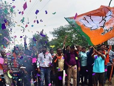 BJP supporters celebrate their party's victory in the state. PTI