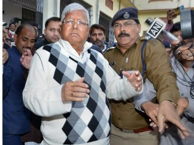 File image of Lalu Prasad Yadav escorted by police officials after being convicted in a fodder scam case,. PTI