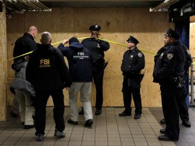 FBI members enter the crime scene beneath the New York Port Authority Bus Terminal following an attempted detonation on Monday. Reuters