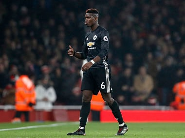 Manchester United's Paul Pogba leaves the pitch after being shown a red card against Arsenal. AP