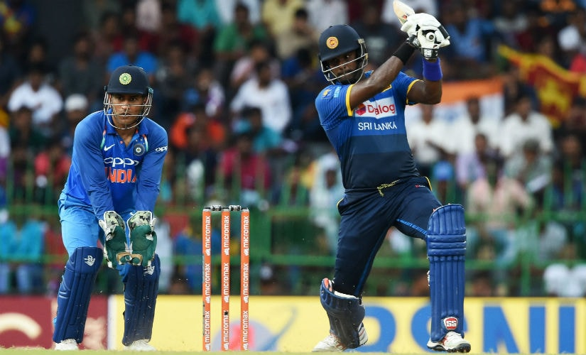 Sri Lanka's Angelo Mathews plays a shot as Indian wicketkeeper MS Dhoni looks on during the final ODI in Colombo in September. AFP