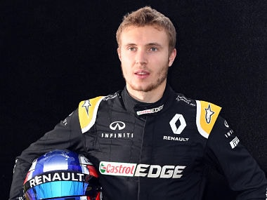 Renault's Russian reserve driver Sergey Sirotkin poses for a photo in Melbourne on March 23, 2017, ahead of the Formula One Australian Grand Prix. / AFP PHOTO / William WEST / -- IMAGE RESTRICTED TO EDITORIAL USE - STRICTLY NO COMMERCIAL USE --