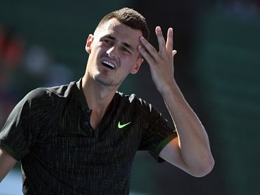 Bernard Tomic of Australia reacts during his match against Yoshihito Nishioka of Japan at the men's singles match of the Kooyong Classic tennis tournament in Melbourne on January 9, 2018. / AFP PHOTO / William WEST / IMAGE RESTRICTED TO EDITORIAL USE - STRICTLY NO COMMERCIAL USE