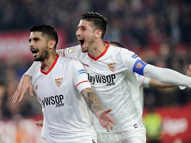 Sevilla's Argentinian midfielder Ever Banega (L) celebrates with Sevilla's Spanish defender Sergio Escudero after scoring a goal during the Spanish 'Copa del Rey' (King's cup) quarter-final second leg football match between Sevilla FC and Club Atletico de Madrid at the Ramon Sanchez Pizjuan stadium in Sevilla on January 23, 2018. / AFP PHOTO / CRISTINA QUICLER