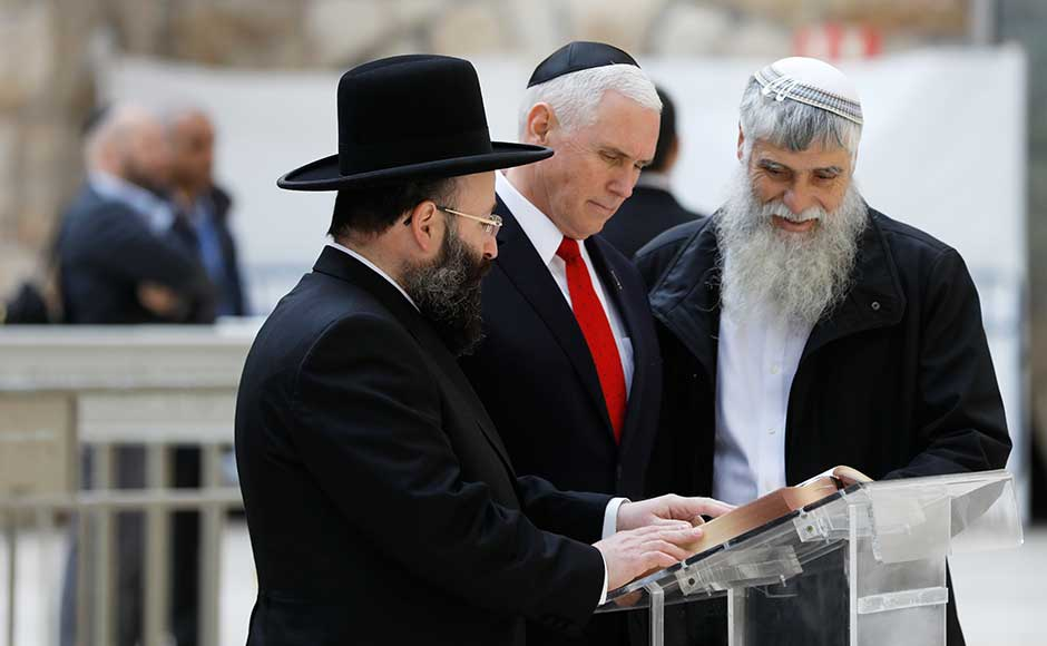 US vice-president Mike Pence visited Jerusalem's Western Wall on Tuesday while Palestinians held a general strike after denouncing his fervently pro-Israel speech the previous day as