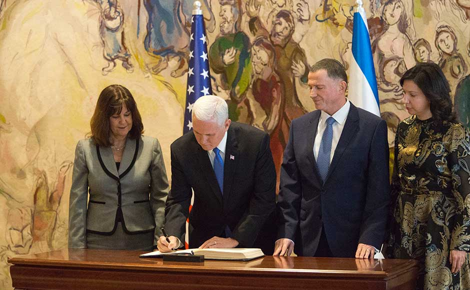 The devout Christian's speech to the Israeli parliament on Monday laden with biblical references was praised by Israelis as perhaps the best they could ever hope for from a US administration, but Palestinians saw it as confirming some of their worst fears. Pence signs the guest book in Israel's parliament in Jerusalem. AP