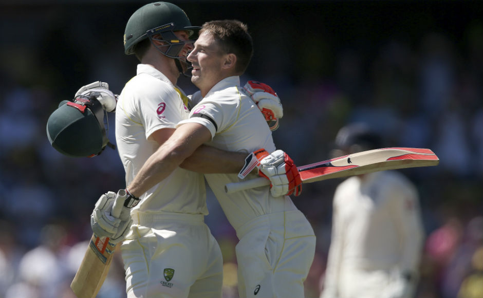 Maintaining his good form, Shaun Marsh scored his second century in the series. Here he embraces his brother Mitchell after reaching the three-figure mark. AP