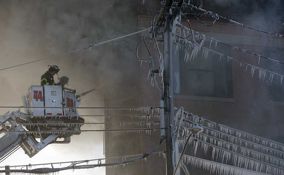 More than 200 firefighters were still battling the blaze in frigid temperatures of around 15 degrees Fahrenheit (-9.4 Celsius) two hours after it started, said Reilly, adding that the cause was yet to be determined. AP