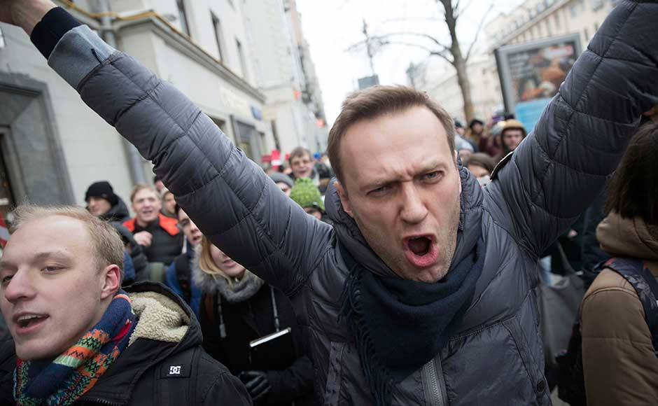 Navalny, who has been blocked from running in Russia's 18 March presidential election, called for nationwide protests on Sunday. AP