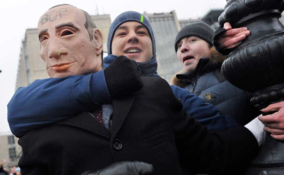 Several hundred demonstrators assembled on the centre square of the Pacific port city of Vladivostok, complaining both of President Vladimir Putin, who is running for a fourth term, and of the exclusion of Navalny. AP