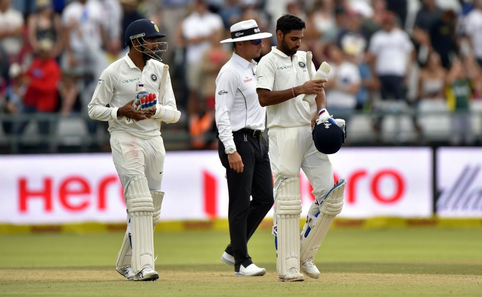 The inevitable after Tea as India were bowled out for 135. Here Mohammed Shami and Jasprit Bumrah leave the field dejected after India lost to South Africa by 72 runs. AP