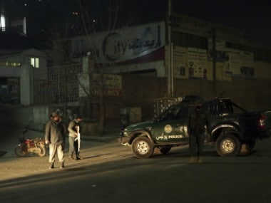 Policemen block the main road near the Intercontinental Hotel after a deadly attack in Kabul. AP