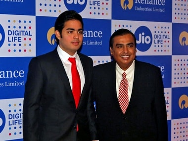 Mukesh Ambani (R), chairman of Reliance Industries Ltd, poses with his son Akash before addressing the company's annual general meeting in Mumbai, India September 1, 2016. REUTERS/Shailesh Andrade - D1BETYTCCAAA