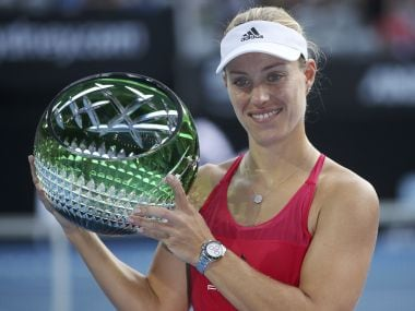 Angelique Kerber holds her trophy as she celebrates her win over Ash Barty. AP