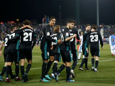 Real Madrid's Marco Asensio celebrates scoring their first goal with Raphael Varane and teammates. Reuters