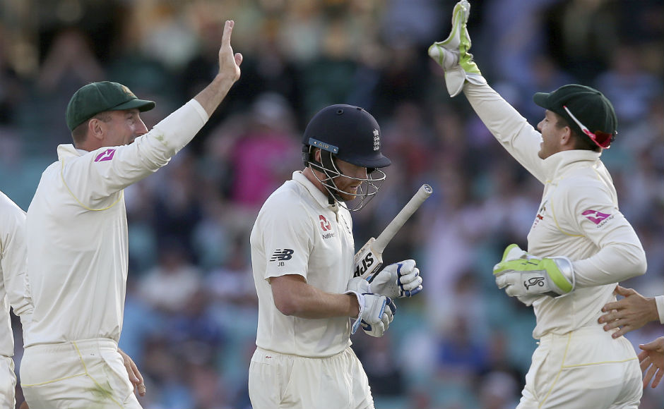 Australia's Shaun Marsh (L) celebrates with teammate Tim Paine after the wicket of England's Jonny Bairstow (C) on day 1 of final Test. AP