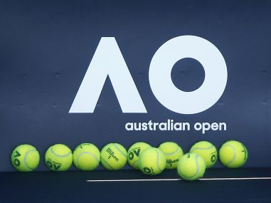 Tennis balls are pictured in front of the Australian Open logo before the tennis tournament. Reuters