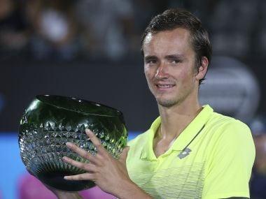 Daniil Medvedev holds the trophy after his win over Alex De Minaur. AP