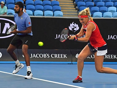 Hungary's Timea Babos and India's Rohan Bopanna in their mixed doubles game against Australia's Ellen Perez and Andrew Whittington at the Australian Open tennis championships in Melbourne, Australia Sunday, Jan. 21, 2018. (AP Photo/Andy Brownbill)